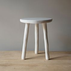 white resin side tables