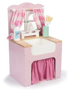 A pretty in pink-and-white, vintage-style kitchen sink will make the perfect addition to a child's toy kitchenette.