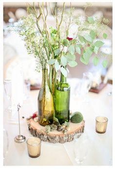 wedding centerpiece with bottles and wooden disk   bottle centerpiece with burlap + wood slab...i can drink all the wine ...