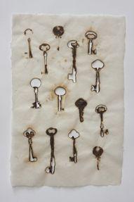 """Handmade paper by Helen Hiebert    Cast cotton paper pulp, letterpress text, burnt keys on handmade abaca paper  15"""" x 32""""  2010"""