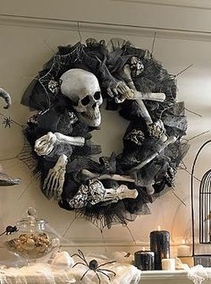 Send chills down the spines of your guests this Halloween with the Bony Wreath that offers creepy character through black ribbon, tulle, webs and intricately detailed bones.