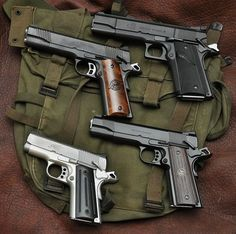 well made 1911 handguns; ranging from Kimber to Wilson Combat to LAR. This is a good example at how massive the LAR Grizzly is in comparison to it's relatives. The one pictured is chambered in 44 Magnum, which is pretty uncommon since most. Weapons Guns, Guns And Ammo, Colt M1911, Revolvers, Rifles, Wilson Combat, 1911 Pistol, By Any Means Necessary, Home Defense