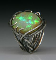 Jewels Curnow creation, custom alloy poured from an ingot and handmade into wire. The stone is a Ethiopian Opal. Opal Jewelry, Jewelry Art, Jewelry Rings, Unique Jewelry, Jewelery, Handmade Jewelry, Opal Rings, Silver Rings, Custom Wedding Rings