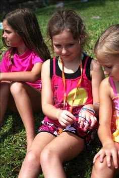 Me at camp! (I'm the girl in the pink swim shirt with the straight brown hair)