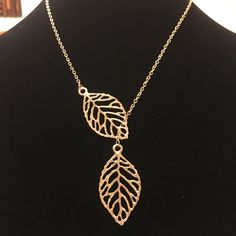 Two Leaf Necklace Pretty gold tone filigree leaves in a lariat style necklace. Chain is delicate looking, but is quite sturdy! Perfect to wear with anything!  Bundle 2 or more listings and save 20%!! Jewelry Necklaces