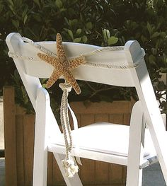 Chair decoration for beach weddings.. the simplicity of the starfish and rope is gorgeous to me