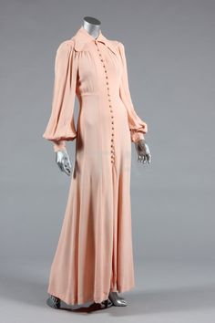 Mid-1970s Ossie Clark for Radley peach moss crepe gown, labeled, button-fronted, long full sleeves, and curved collar.
