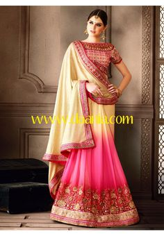 Faux georgette cream and pink half and half saree.Embroidered foliage patterns lower part and net second half adorned with the heavy embroidered floral patterns on the border that adds the look. Comes with matching blouse. Color : Pink, Cream Fabric : Faux Georgette Occassion : Party, Bridal