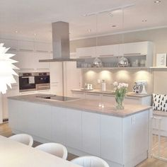 Modern White Kitchen   White Cupboards, Grey Bench Tops And White And  Silver Accessories