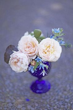A trio of garden roses with pops of tweedia | Brides.com