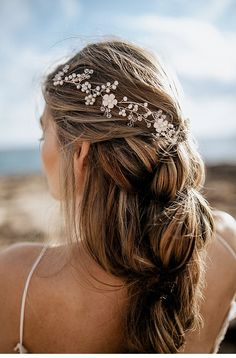Embedded in elaborate braided hairstyles white pearls sparkle valuably between strands of hair or ensnare filigree blossoms of Quartz.