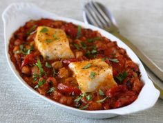 Oven-baked cod on Spanish chickpeas, as featured in Week 43 of Everyday Mediterranean. Subscribe here: http://nutrelan.com/everyday-mediterranean-meal-plan-how-it-works/.