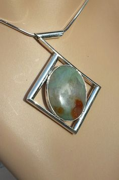 Another uniq jewelry pendant combining Sterling Silver and Stone. A bit abstract, but really looks good with neutral color outfits. Check it out at the Etsy listing at https://www.etsy.com/listing/197348612/sterling-silver-pendant-freeform