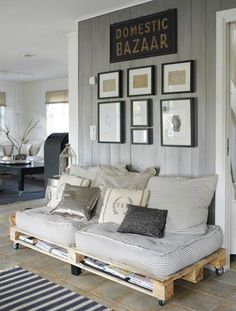 Lovely, relaxed, cozy, and clean...  Grey has become the new 'it' colour and for good reason. Great shabby chic creation with the mattress cushions on the pallets. Pallets can usually be picked up for free... my kind of budget-maker. @Rip Rainer