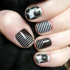 Love this black, white, and silver manicure using Static, Flapper, and Black & White Skinny Jamberry wraps! #nails #nailart #manicure #jamberry #black #white #silver