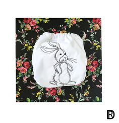Dark brown sketch embroidered rag rabbit on white PUL. Embroidery is fully lined with two extra layers of PUL to create a solid barrier from