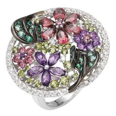 Ring with a mix of sterling silver and gold, set with Swarovski gems, passion topaz, amethyst, peridot, citrine and garnet combined with diamonds by Aaron Shum