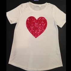 ❤️ tee ❤️❤️The perfect white tee.❤️❤️Glittered heart. Short sleeve. Polyester, rayon, & spandex mix. Sizes S M L available. Please comment size & I will make you a new listing.  trades ❤️bundle discount only Tops Tees - Short Sleeve