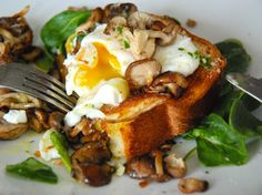ummm that egg!    Poached Eggs on Toasted Brioche with Garlicky Mushrooms by Kitchen Culinaire