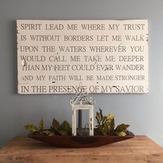 Spirit lead me where my trusts are without borders lyrics painted on barn wood…