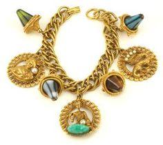 Oriental theme charm bracelet $89 http://www.vintagecostumejewelryaddiction.com/vcja3098.html