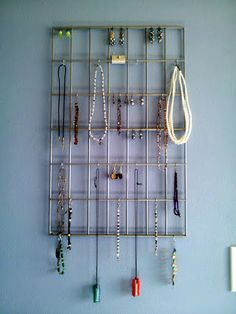 This is the jewelry holder that I made. It a piece of a shelving unit found at Menard's, with small S-hooks for necklaces and bracelets.