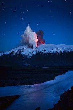 Eyjafjallajokull Eruption....ok the stark contrast between the silent serenity of the night and that chaotic, forceful eruption really strike me in this photo