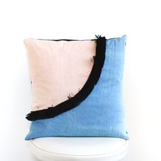 Who doesnt love a little fringe?! This denim with peachy pink linen and cotton fringe throw pillow is one of a kind. Its the perfect pop of color for your living room or bedroom decor. We just love the color combo, and hope you do too. 18 x 18 square pillow. Pillow insert included. Flap back for option to remove pillow insert.  Hand wash cold, lay flat to dry.  Made in the U.S.A.  See more throw pillows here: https://www.etsy.com/shop/CalhounAndCo/?section_id=206...