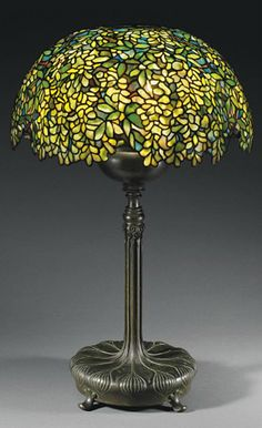 Tiffany OFF! TIFFANY STUDIOS A Laburnum Leaded Glass Shade circa 1910 together with an assembled bronze adjustable base 34 in.) high 21 in. Old Lamps, Antique Lamps, Antique Lighting, Vintage Lamps, Louis Comfort Tiffany, Stained Glass Light, Tiffany Stained Glass, Tiffany Glass, Tiffany Kunst