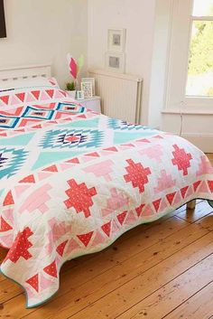 """How I adore this """"Jolly Rancher/Aztec/Native American"""" quilt by Cristina Tepsick of Pretty Little Quilts. I feel like I need to make a similar one of my own ASAP!"""