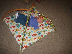 """Here it is, my newest creation. (Not the baby, she's been around for 7 weeks, the playmat.) Cream """"needed"""" a playmat and I decided to try . Baby Sister, Mom And Baby, Baby Love, Baby Gym, Baby Play, Getting Ready For Baby, Baby Crafts, Kids Crafts, Cool Baby Stuff"""