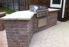 Again, Hinkle - I just love this grill station. Its beautiful, though i would like it lighter colors on the brick.  I don't really care for that stamped floor pattern, FYI...it reminds me of the 70s