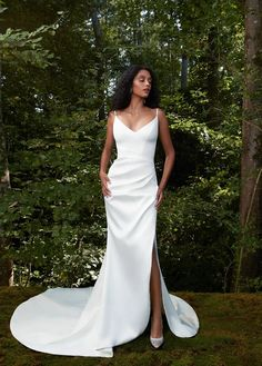 Soft V-neck spaghetti strap stretch crepe back satin column gown with buttons to the godet and diagonal draping at hip opening to a striking slit at front.  Anne Barge | Style: KISSME Anne Barge Wedding Dresses, Wedding Dress Low Back, Crepe Wedding Dress, Spaghetti Strap Wedding Dress, Wedding Dresses With Straps, Fit And Flare Wedding Dress, Wedding Dress Styles, Dream Wedding Dresses, Sheath Wedding Dresses