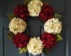 A hydrangea wreath arrangement in burgundy colors that make for an inviting door decoration. This elegant wreath is handcrafted on a grapevine base with artificial hydrangea flowers and leaf greenery accents around wreath perimeter. Summer Door Wreaths, Wreaths For Front Door, Holiday Wreaths, Christmas Decorations, Holiday Decor, Winter Wreaths, Wreath Fall, Fall Decor, Year Round Wreath