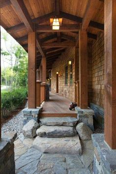 beautiful craftsman entry... love the stone to wood path.