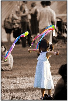 Young girl spinning poi