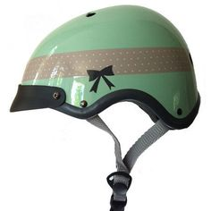 This Sawako Furuno ribbon cycling helmet is a trend-right and cute to boot. Its glossy green pastel color is accented with a perfectly preppy dotted ribbon design and finished off with a painted black bow. Perfect for a ride out to tea! Helmet Accessories, Bicycle Accessories, Cycling Helmet, Bicycle Helmet, Dutch Bicycle, Cool Bike Helmets, Cycle Chic, Bike Style, Vintage Bicycles