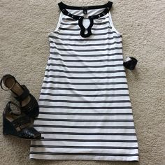 """WHBM black & white stripe dress WHBM black and white stripe dress. Super cute nautical look. Super cute detailing around the neckline, silver hardware. Sleeveless. Lined. 90 rayon 10 spandex. Laying flat approx 34"""" long, approx 17"""" pit to pit. Size S. Excellent condition. White House Black Market Dresses"""