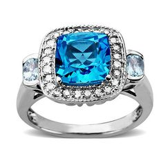 An inviting cushion-cut 2.90 carat blue topaz pool is crested by the shimmer of .20 ct. t.w. diamonds for a look that will make waves. The bold fashion ring