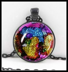 Beautiful Alcohol Ink Art Pendant  First photo is the pendant you will receive...other photos show color and size.  This is a beautiful pendant. Looks even better in person! READY TO SHIP!  It measures 30mm (1 1/4) in diameter and comes with a black 24 adjustable rolo style chain with a lobster claw closure. Multi-layered process carefully sealed under a super clear glass dome which brings the pendant to life. Bright bold colors and mixed metals create a truly one-of-a-kind piece of wearable…