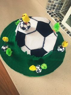 Football themed Easter bonnet Boys Easter Hat, Easter Bonnets For Boys, Easter Hat Parade, Easter Garden, Easter Art, Easter Crafts, Easter Ideas, Crazy Hat Day, Crazy Hats