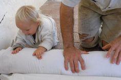 toddler helps prepare wool for felting