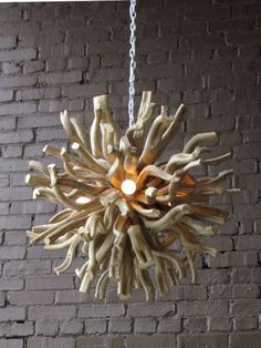This casual lighting fixture is perfect in a room with driftwood accents. It is made of wood and measures 28