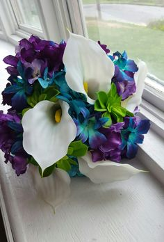 Wedding bouquet with while calla lilies, blue galaxy orchids, lime green succulents, and teal and purple hydrangeas.  Find me on Facebook, Brandie's Bouquets
