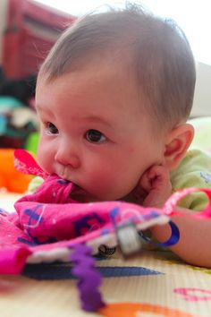 Babies chew everything and there is a lot of drool. The only solution is to give them something soft and absorbent to chew on.