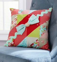 Use large rickrack and charm squares to create a square patchwork pillow.
