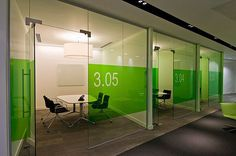 Small glassed-in meeting rooms let light in but keep noise out.