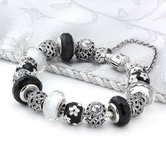 PANDORA Black Tie Affair Bracelet -  Get dressed to impress!!  The PANDORA Black Tie Affair Bracelet features beautiful black and white enamel, murano glass, and cubic zirconias. This black and white themed bracelet is just begging to be worn to your elegant affair!! Get this dashing bracelet now!
