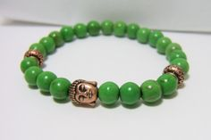 "Apple Green Magnesite Bead Bracelet ~ 8mm Magnesite Gemstone Beads, Copper Buddha Head & Copper Rondelle Spacer beads ~ stretch cord, 7.5"" www.sgtpepperscreations.etsy.com #buddha #boho #magnesite #gemstonejewelry #applegreen"