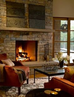 Stone fireplace with raised hearth.  Looks slightly similar to ours....love the raised hearth for extra seating :)